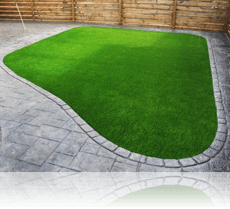 3G Astro Turf edged by Ashlar Slate Single Cobble Edge